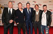 Martin Kemp Gary Kemp Tony Hadley Steve Norman John Keeble of Spandau Ballet during the LEA Live Entertainment Award 2015 at Festhalle Frankfurt on...