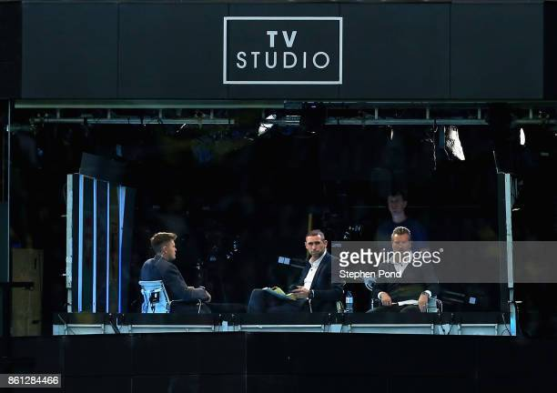Martin Keown and Robbie Savage watch on from the BT Sport Studio during the Premier League match between Watford and Arsenal at Vicarage Road on...