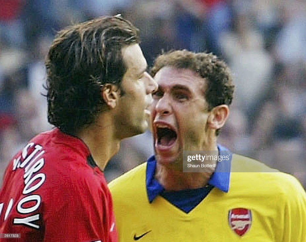 Martin Keown of Arsenal shows his feelings at Ruud Van Nistelrooy of Man Utd after Van Nistelrooy missed his penalty during the FA Barclaycard Premiership match between Manchester United and Arsenal at Old Trafford on September 21, 2003 in Manchester, England.