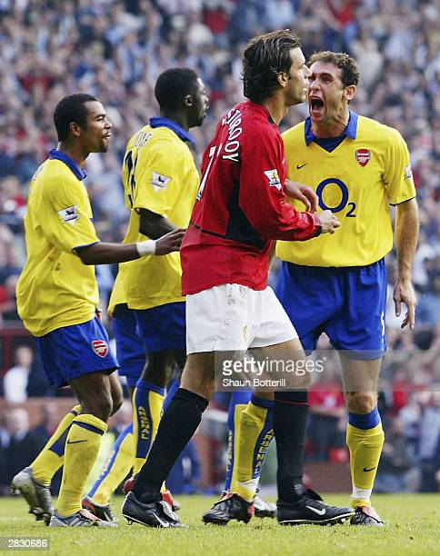 Martin Keown of Arsenal shows his feelings at Ruud Van Nistelrooy of Man Utd after he misses his penalty during the FA Barclaycard Premiership match...