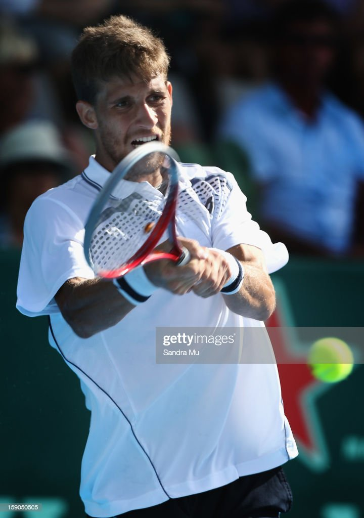 Martin Kilzan of Slovakia plays a backhand in his first round match against Xavier Malisse of Belgium during day one of the Heineken Open at ASB Tennis Centre on January 7, 2013 in Auckland, New Zealand.