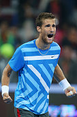 Martin Klizan of Slovakia celebrates winning his match against Rafael Nadal of Spain during during day seven of the China Open at the National Tennis...