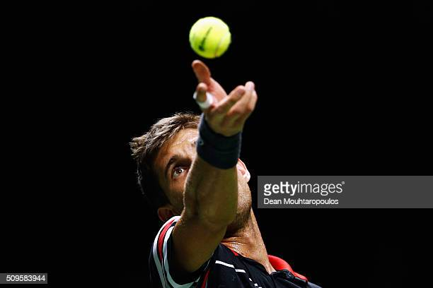 Martin Klizan of Slovakia in action against Marcos Baghdatis of Cyprus during day 4 of the ABN AMRO World Tennis Tournament held at Ahoy Rotterdam on...