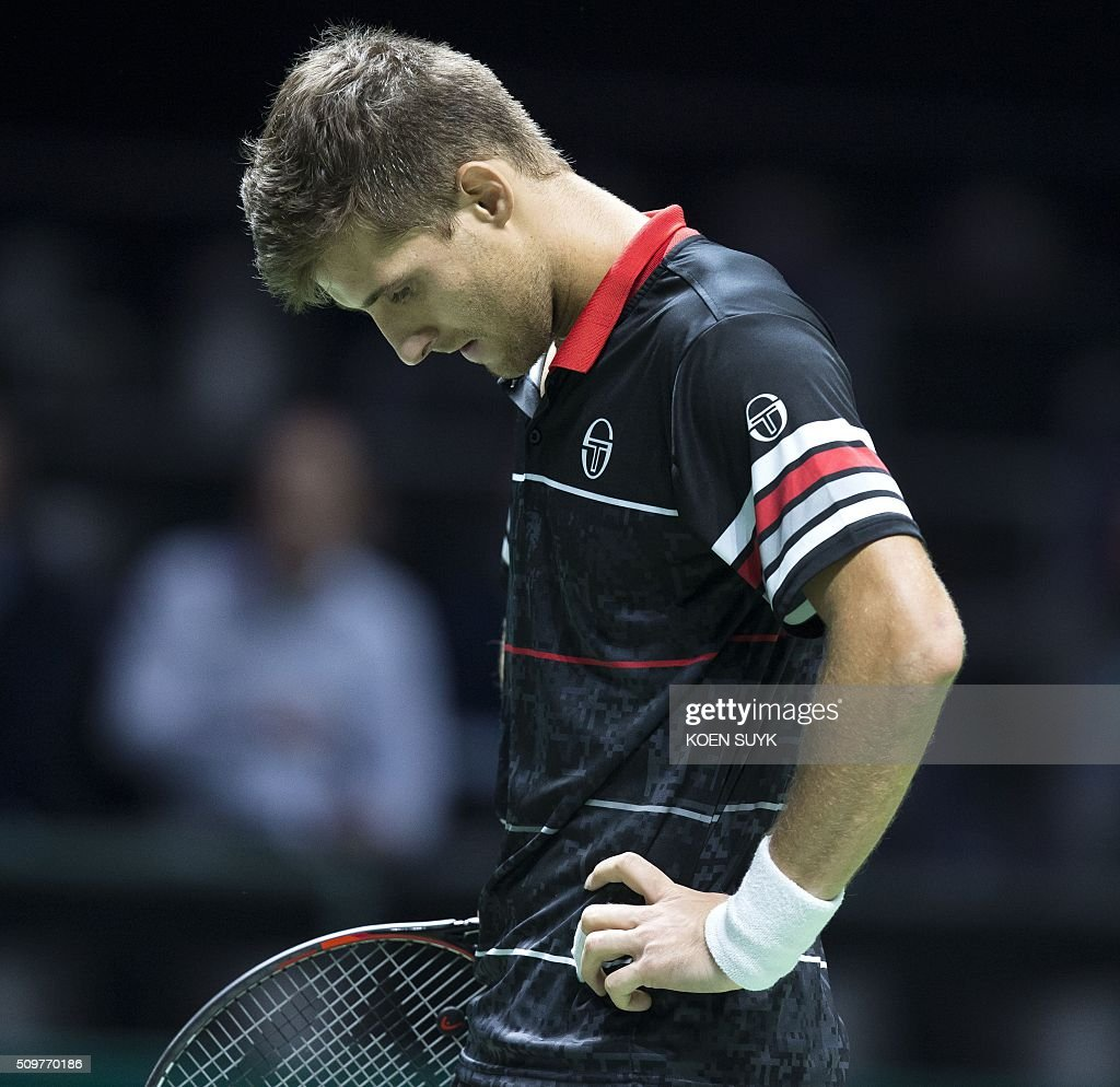 Martin Klizan of Slovakia lows his head during his match against Roberto Bautista Agut of Spain in the quarterfinals of the ABN AMRO World Tennis Tournament in Rotterdam, Netherlands, on February 12, 2016. / AFP / ANP / Koen Suyk / Netherlands OUT