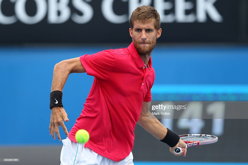 Martin Klizan of Slovakia plays a forehand in his third round match against Stephane Robert of France during day six of the 2014 Australian Open at Melbourne Park on January 18, 2014 in Melbourne, Australia.