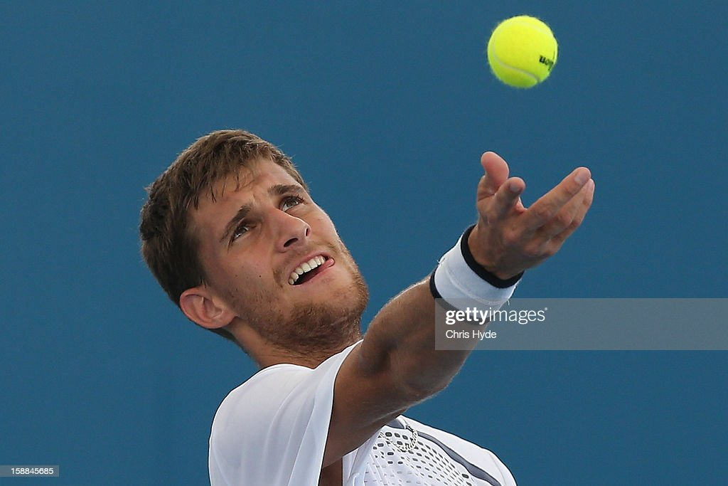 Martin Klizan of Slovakia serves during his match against Denis Istomin of Uzbek on day three of the Brisbane International at Pat Rafter Arena on January 1, 2013 in Brisbane, Australia.