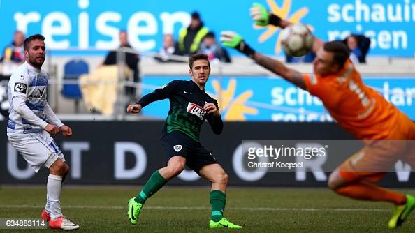Martin Kobylanski of Muenster scores the second goal against Mark Flekken of Duisburg and Nico Klotz of Duisburg during the Third League match...
