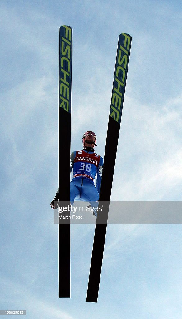 Martin Koch of Austria competes during the trial round for the FIS Ski Jumping World Cup event of the 61st Four Hills ski jumping tournament at Olympiaschanze on December 31, 2012 in Garmisch-Partenkirchen, Germany.