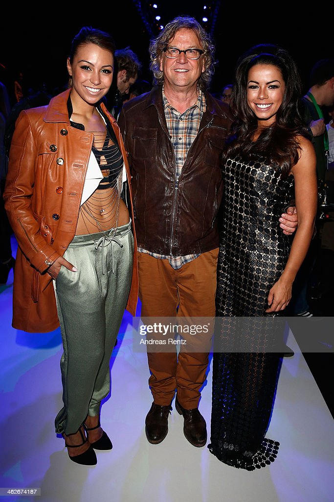 Martin Krug (C) and Fernanda Brandao (R) attend the Riani show during Mercedes-Benz Fashion Week Autumn/Winter 2014/15 at Brandenburg Gate on January 14, 2014 in Berlin, Germany.