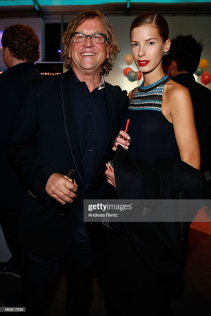 <a gi-track='captionPersonalityLinkClicked' href=/galleries/search?phrase=Martin+Krug&family=editorial&specificpeople=574482 ng-click='$event.stopPropagation()'>Martin Krug</a> and Julia Trainer arrive for the Marcel Ostertag show during Mercedes-Benz Fashion Week Autumn/Winter 2014/15 at Brandenburg Gate on January 15, 2014 in Berlin, Germany.