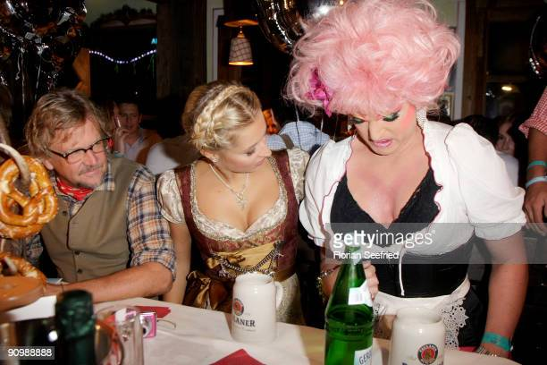 Martin Krug Verena Kerth and Olivia Jones attend the Oktoberfest 2009 at Kaefer Schaenke at the Theresienwiese on September 20 2009 in Munich Germany...