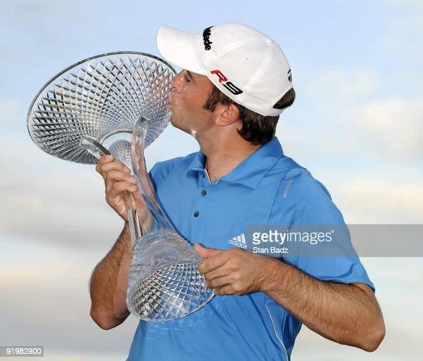 Martin Laird kisses the winner's trophy on the 18th green following a three man playoff during the final round of the Justin Timberlake Shriners...
