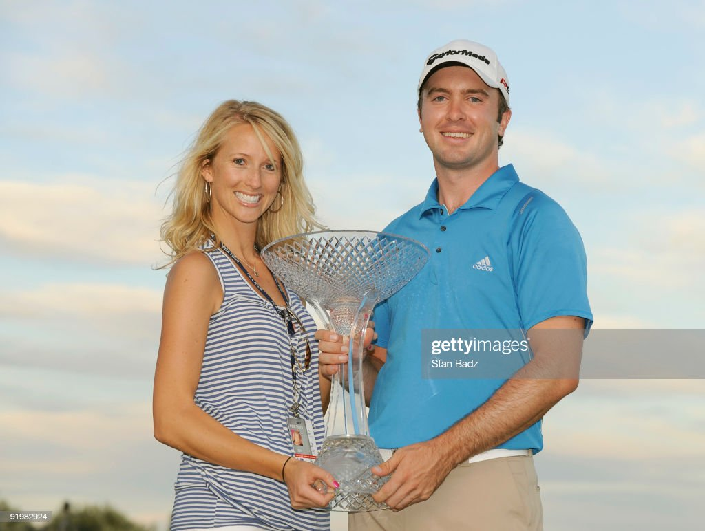 Martin Laird of Scoltand with his girlfriend Meagan holds the winner trophy during the final round of the Justin Timberlake Shriners Hospitals for...
