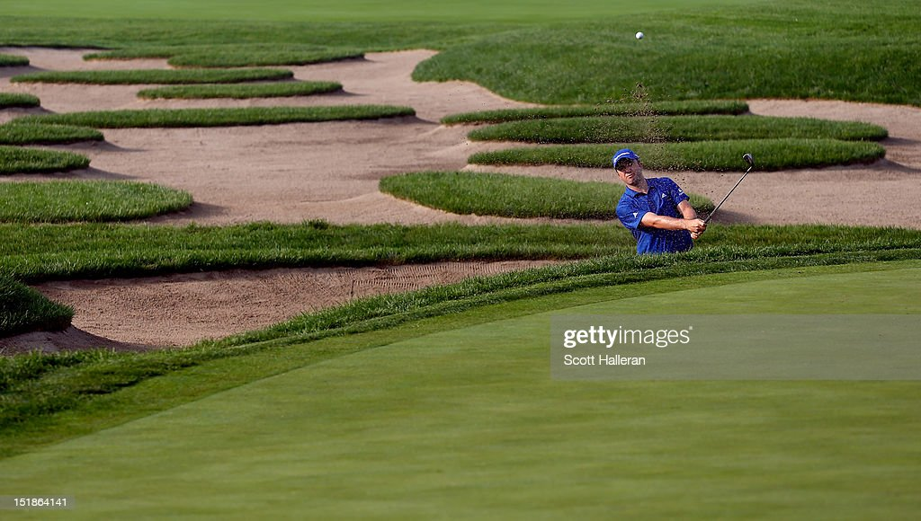 <a gi-track='captionPersonalityLinkClicked' href=/galleries/search?phrase=Martin+Laird&family=editorial&specificpeople=4333409 ng-click='$event.stopPropagation()'>Martin Laird</a> of Scotland plays a bunker shot on the 11th hole during the second round of the BMW Championship at Crooked Stick Golf Club on September 7, 2012 in Carmel, Indiana.