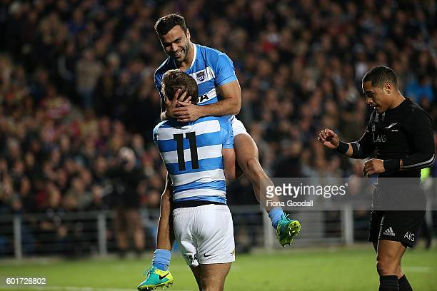 Martin Landajo of Argentina congratulates team mate Santiago Cordero after he scores a try in the first minutes during the Rugby Championship match...