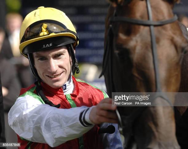 Martin Lane celebrates with Philario after winning the Boylepokercom Handicap during the Boylesportscom Irish 2000 Guineas Day at Curragh Racecourse...