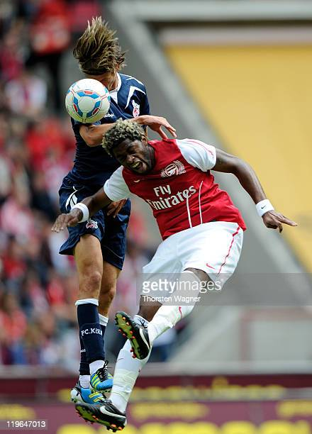 Martin Lanig of Koeln battles for the ball with Alex Song of Arsenal during the International preseason friendly match between 1FC Koeln and Arsenal...