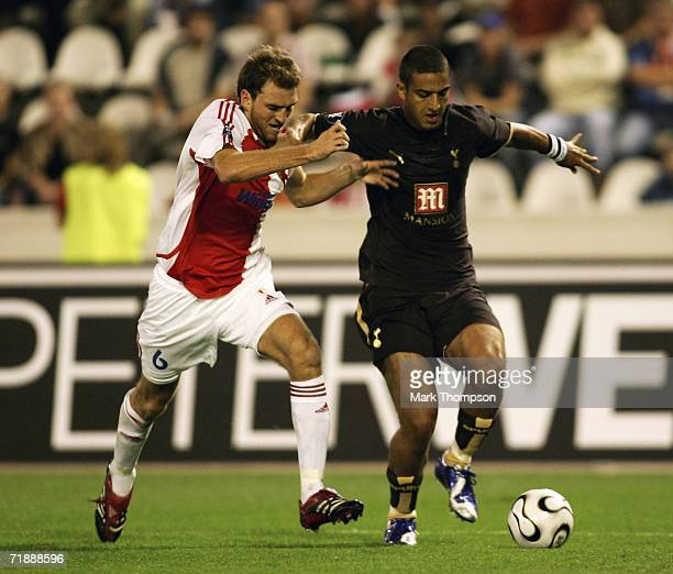 Martin Latka of Slavia Prague battles with Ahmed Mido of Tottenham during the first round first leg UEFA Cup match between SK Slavia Prague and...