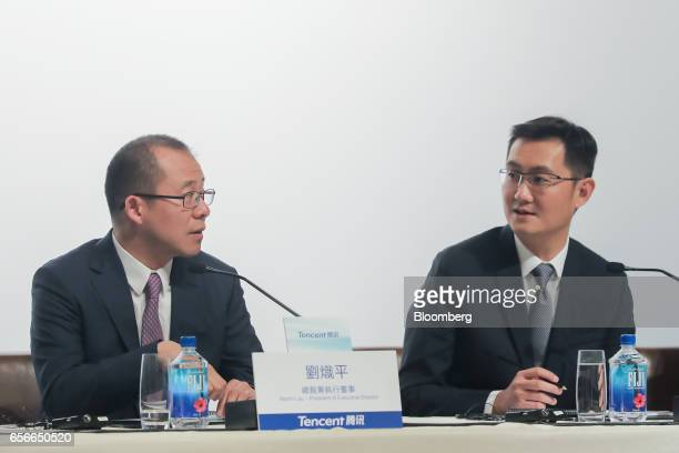 Martin Lau president of Tencent Holdings Ltd left and Ma Huateng chairman and chief executive officer attend a news conference in Hong Kong China on...