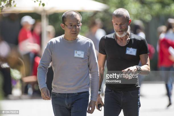 Martin Lau president of Tencent Holdings Ltd left and Vivi Nevo venture Capitalist with NV Investments walk the grounds after a morning session...