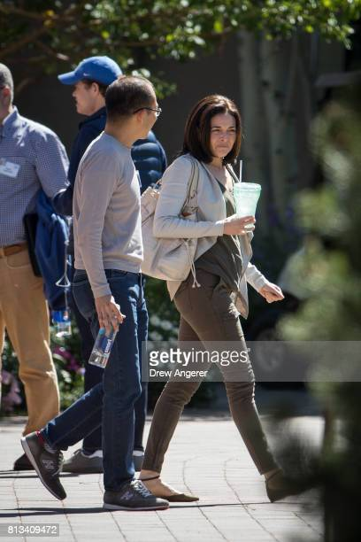 Martin Lau president of Tencent Holdings walks with Sheryl Sandberg chief operating officer of Facebook during the second day of the annual Allen...