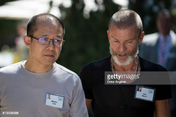 Martin Lau president of Tencent Holdings walks with venture capitalist Aviv 'Vivi' Nevo during the second day of the annual Allen Company Sun Valley...