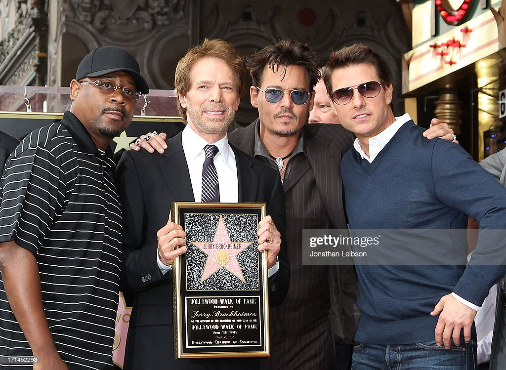 Martin Lawerence, producer <a gi-track='captionPersonalityLinkClicked' href=/galleries/search?phrase=Jerry+Bruckheimer&family=editorial&specificpeople=203316 ng-click='$event.stopPropagation()'>Jerry Bruckheimer</a>, <a gi-track='captionPersonalityLinkClicked' href=/galleries/search?phrase=Johnny+Depp&family=editorial&specificpeople=202150 ng-click='$event.stopPropagation()'>Johnny Depp</a> and <a gi-track='captionPersonalityLinkClicked' href=/galleries/search?phrase=Tom+Cruise&family=editorial&specificpeople=156405 ng-click='$event.stopPropagation()'>Tom Cruise</a> attend the ceremony honoring <a gi-track='captionPersonalityLinkClicked' href=/galleries/search?phrase=Jerry+Bruckheimer&family=editorial&specificpeople=203316 ng-click='$event.stopPropagation()'>Jerry Bruckheimer</a> with a Star on The Hollywood Walk of Fame held in front of El Capitan Theatre on June 24, 2013 in Hollywood, California.