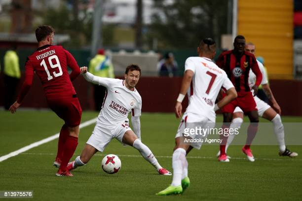 Martin Lines of Galatasaray in action against Dennis Widgren during the UEFA Europa League 2nd Qualifying Round soccer match between Galatasaray and...