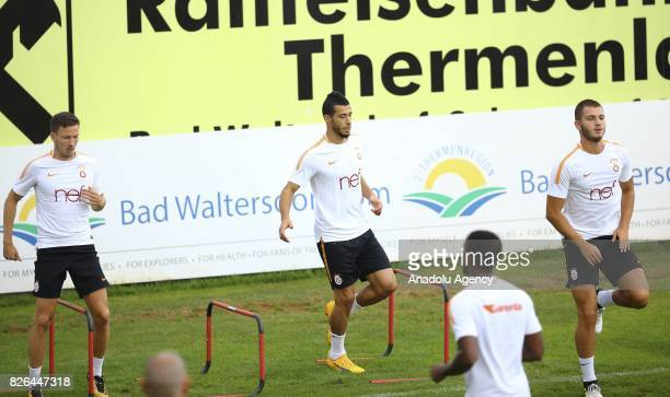 Martin Linnes and Younes Belhanda of Galatasaray attend a training session in Bad Waltersdor town of Graz Austria on August 04 2017