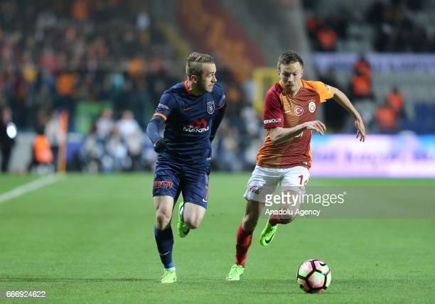 Martin Linnes of Galatasaray in action against Edin Visca of Medipol Basaksehir during the Turkish Spor Toto Super Lig football match between Medipol...