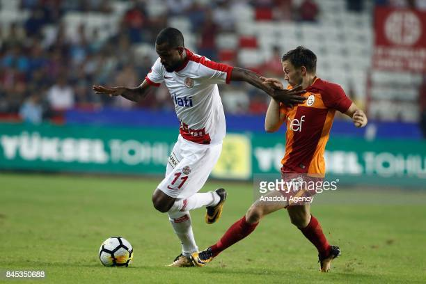 Martin Linnes of Galatasaray in action against Maicon of Antalyaspor during the 4th week of the Turkish Super Lig match between Antalyaspor and...