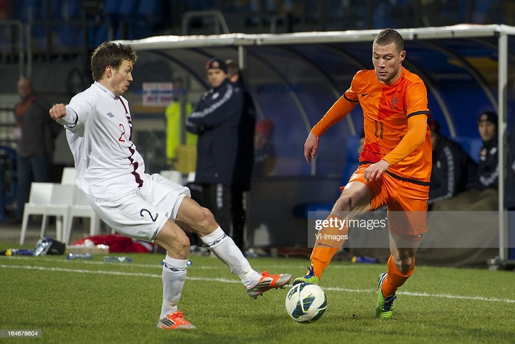 Martin Linnes of Norway U21, Yanic Wildschut of Holland U21 during the friendly match between the Netherlands U21 and Norway U21 at the Mandemakers Stadium on march 25, 2013 in Waalwijk, The Netherlands