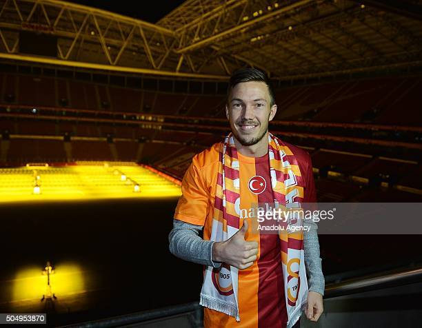 Martin Linnes poses for a photograph with Galatasaray jersey after signing a contract with Galatasaray at Turk Telekom Arena in Istanbul Turkey on...