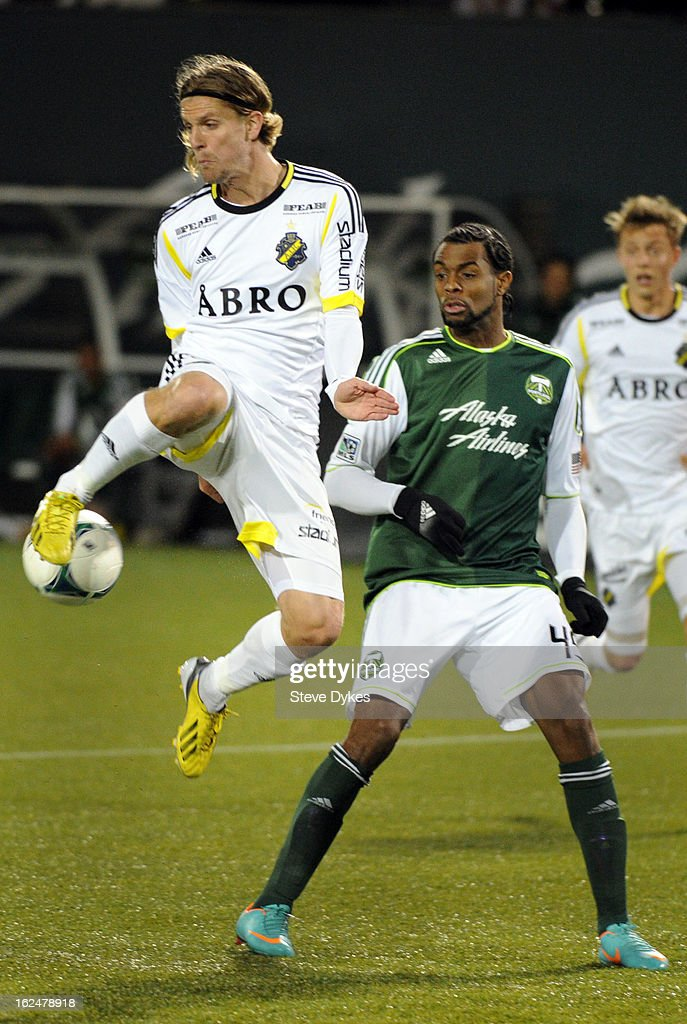 Martin Lorentzson #16 of AIK goes up for a ball in front of <a gi-track='captionPersonalityLinkClicked' href=/galleries/search?phrase=Frederic+Piquionne&family=editorial&specificpeople=660926 ng-click='$event.stopPropagation()'>Frederic Piquionne</a> #45 of the Portland Timbers during the second half of the game at Jeld-Wen Field on February 23, 2013 in Portland, Oregon. The game ended in a 1-1 draw.