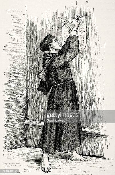 Martin Luther hanging his Ninetyfive Theses on the door of All Saints Church in Wittenberg in 1517 engraving 1882