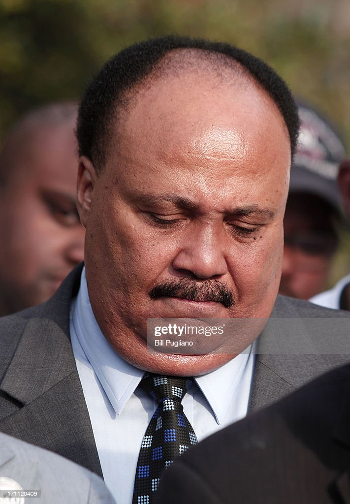 Martin Luther King III bows his head during a prayer at a press conference before marching in the 50th Anniversary Commemorative Freedom Walk June 22, 2013 in Detroit, Michigan. The march commerated the 50th anniversary of civil rights leader Dr. Martin Luther King's Walk To Freedom, which followed the same route through Detroit back in 1963. Guests at the event included Martin Luther King III (Dr. KIng's son), NAACP President Ben Jealous, Rev. Jesse Jackson, Rev. Al Sharpton, Dr. King's advisor Rev. C.T. Vivian, and comedian Dick Gregory.