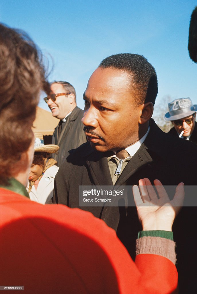 Martin Luther King in conversation while leading march from Selma to Montgomery to protest lack of voting rights for African Americans.
