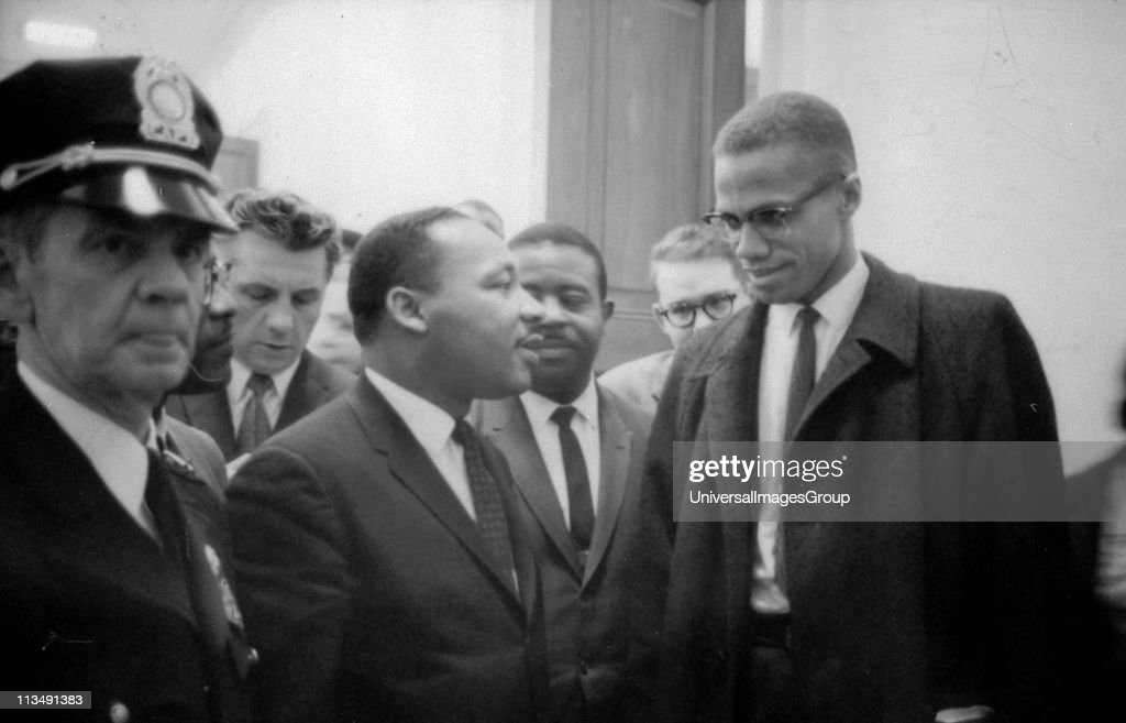 Martin Luther King Jnr and Malcolm X waiting for a press conference 26 March 1964 Photographer Marion STrikoskor