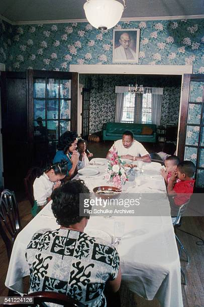Martin Luther King Jr and his family pray before eating their Sunday dinner after church