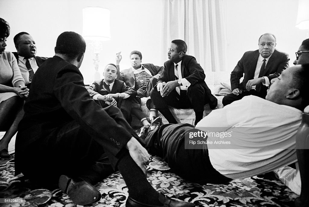 Martin Luther King Jr. and other civil rights leaders meet to discuss strategy during the Selma -Montgomery Civil Rights Marches. Hosea Williams stands up to make a point.