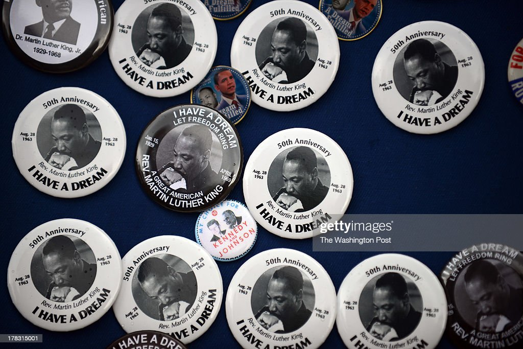 Martin Luther King, Jr., buttons are sold near the National Mall where thousands gather at the National Mall to celebrate the 50th anniversary of the March on Washington.