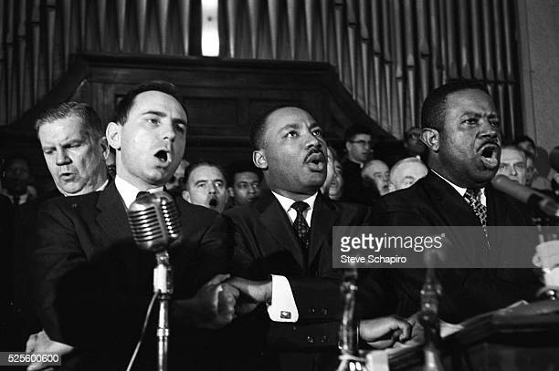Martin Luther King Jr Ralph abernathy and unidentified men sing in a Selma Alabama church