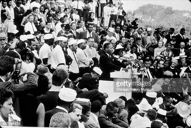 Martin Luther King Jr speaks from behind a podium to a crowd during the March on Washington for Jobs and Freedom in Washington DC August 28 1963