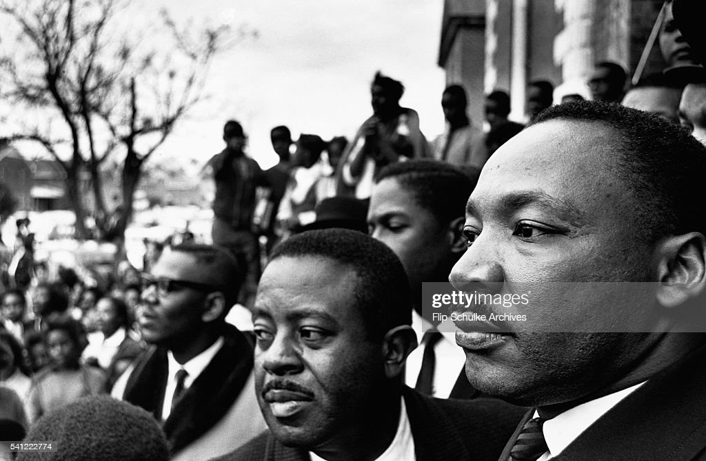 Martin Luther King Jr. stands next to Reverend Ralph Abernathy at a rally held in Selma, Alabama, during marches to Montgomery.