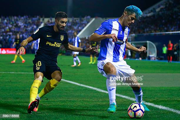 Martin M Mantovani of Deportivo Leganes competes for the ball with Yannick Carrasco of Atletico de Madrid during the La Liga match between Club...