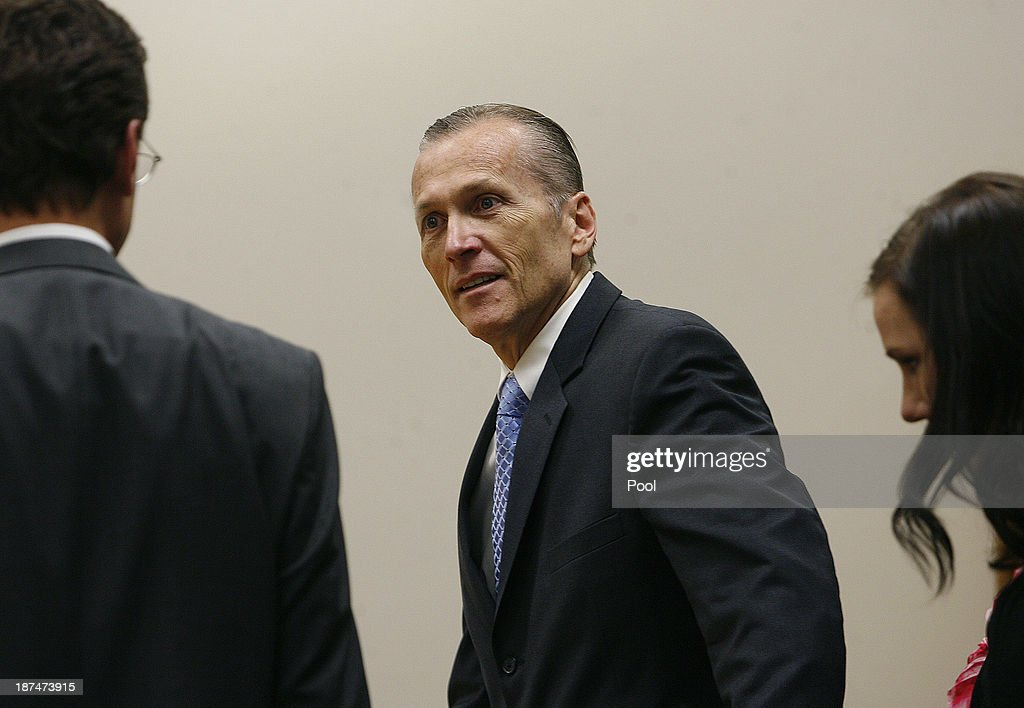 Martin MacNeill greets his defense team as he enters the courtroom to hear the jury verdict for the murder of his wife Michele MacNeill on November 9, 2013 in Provo, Utah. Martin MacNeill, was found guilty of murdering his wife Michele MacNeill in 2007 to continue an affair with a younger woman.