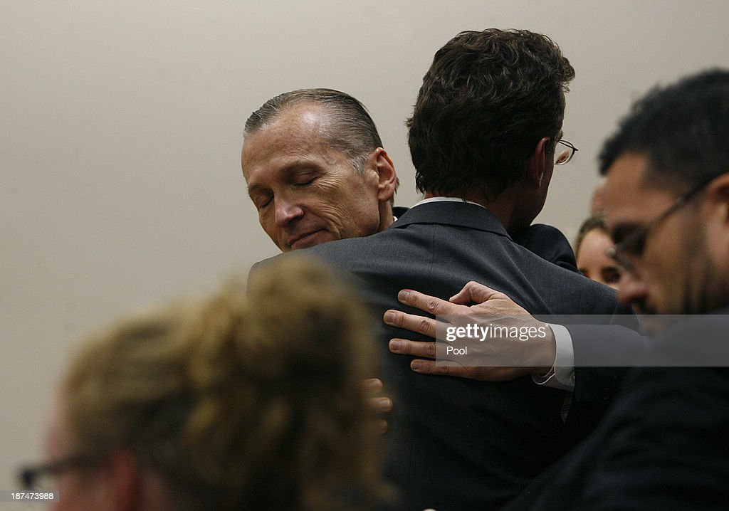 Martin MacNeill hugs his defense team after he was found guilty by the jury for the murder of his wife Michele MacNeill on November 9, 2013 in Provo, Utah. Martin MacNeill, was found guilty of murdering his wife Michele MacNeill in 2007 to continue an affair with a younger woman.