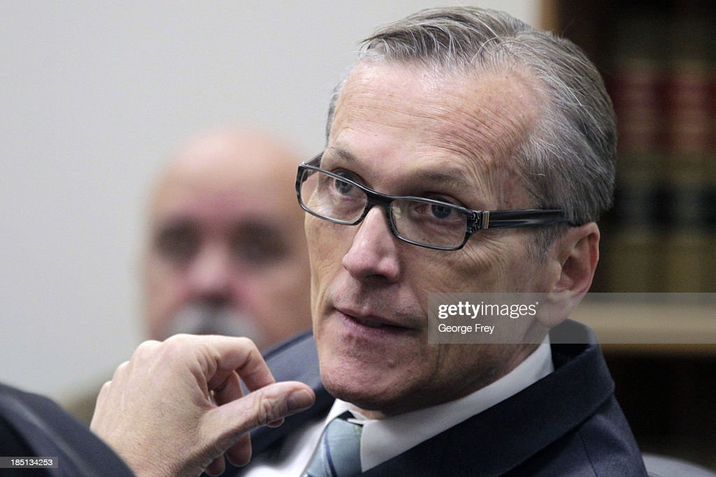 Martin MacNeill interacts with his attorneys in court during the opening day of his trial on October 17, 2013 in Provo, Utah. Dr. Martin MacNeill is accused of killing his wife Michele MacNeill in 2007 to continue an affair with a younger woman.