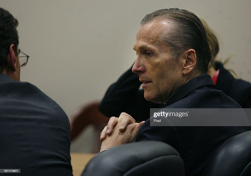 Martin MacNeill talks to his defense team as he sits the courtroom to hear the jury verdict for the murder of his wife Michele MacNeill on November 9, 2013 in Provo, Utah. Martin MacNeill, was found guilty of murdering his wife Michele MacNeill in 2007 to continue an affair with a younger woman.