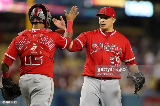 Martin Maldonado of the Los Angeles Angels and David Hernandez of the Los Angeles Angels celebrate their 40 win against the Los Angeles Dodgers at...